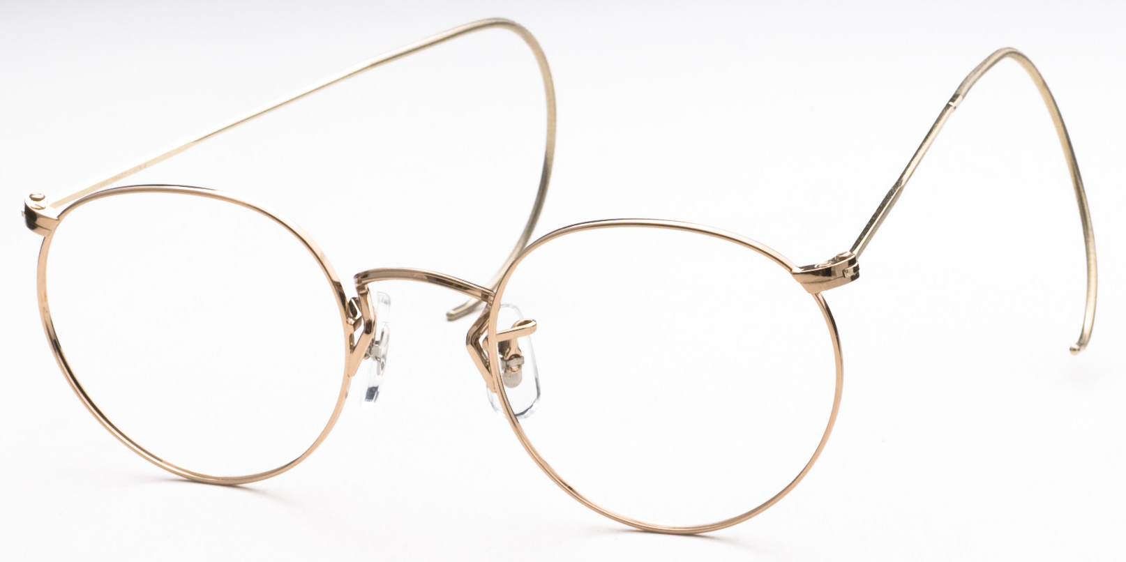 Art-Craft 100A eyeglasses are designed for men and women feature cable temples. The Art-Craft 100A eyeglasses model is made of metal and manufactured in U.S.A..